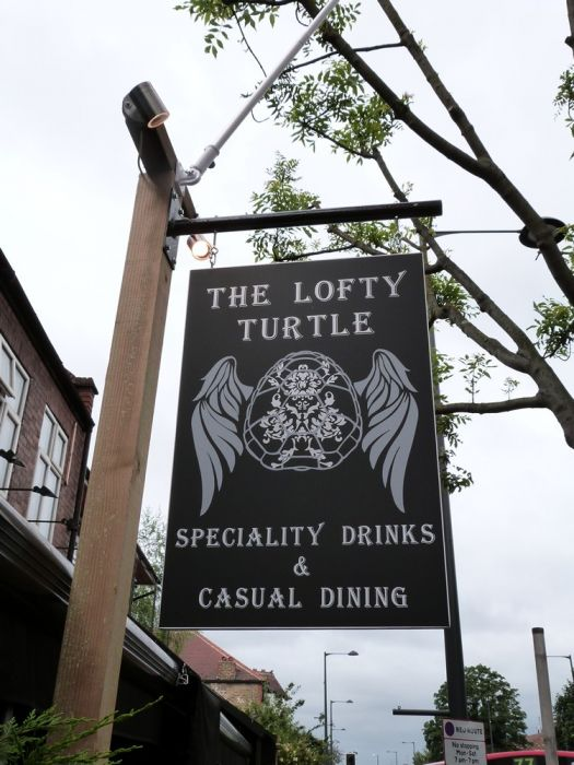 Tradition pub hanging sign, vinyl lettering on acrylic The Lofty Turtle