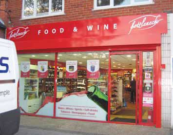 Shop fascia - Food & wine merchant White on red with aluminium tray
