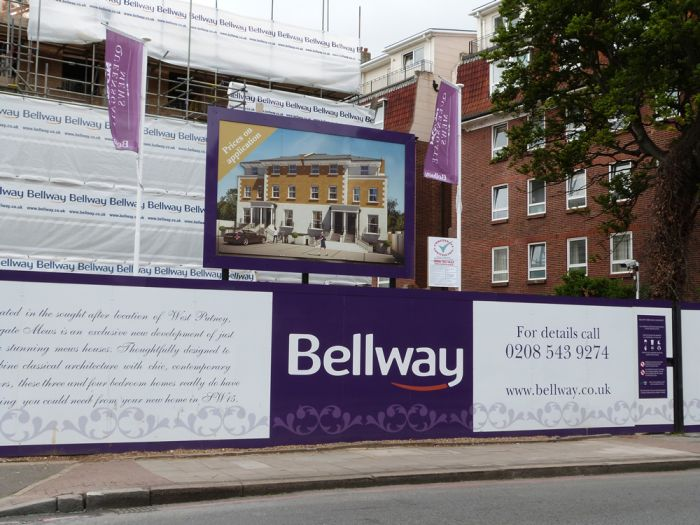 Large hoarding, flags and scaffolding banner Bellway development construction hoarding and scaffolding banner