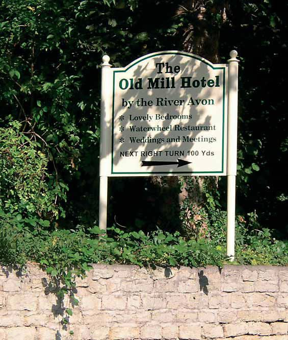Postmounted shaped tray sign with cream finish Old Mill Hotel