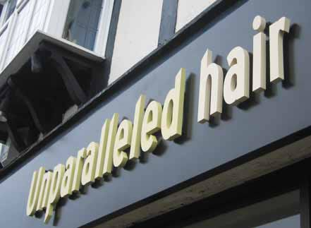 Shop fascia - Unparalleled hair Hairdresser sign featuring built up letters