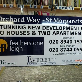 Featherstone Leigh advertising panel mounted on construction hoarding in  Orchard Way - St Margarets, Twickenham