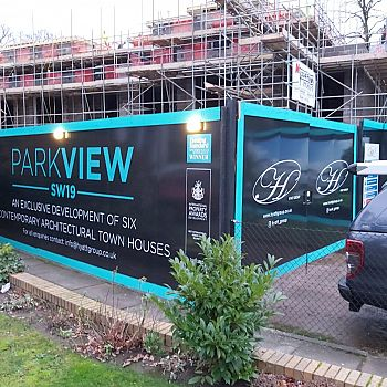 Parkview construction site hoardings advertising a new development