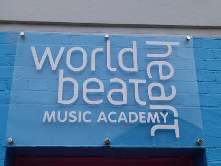 White vinyl logo for music academy on clear acrylic